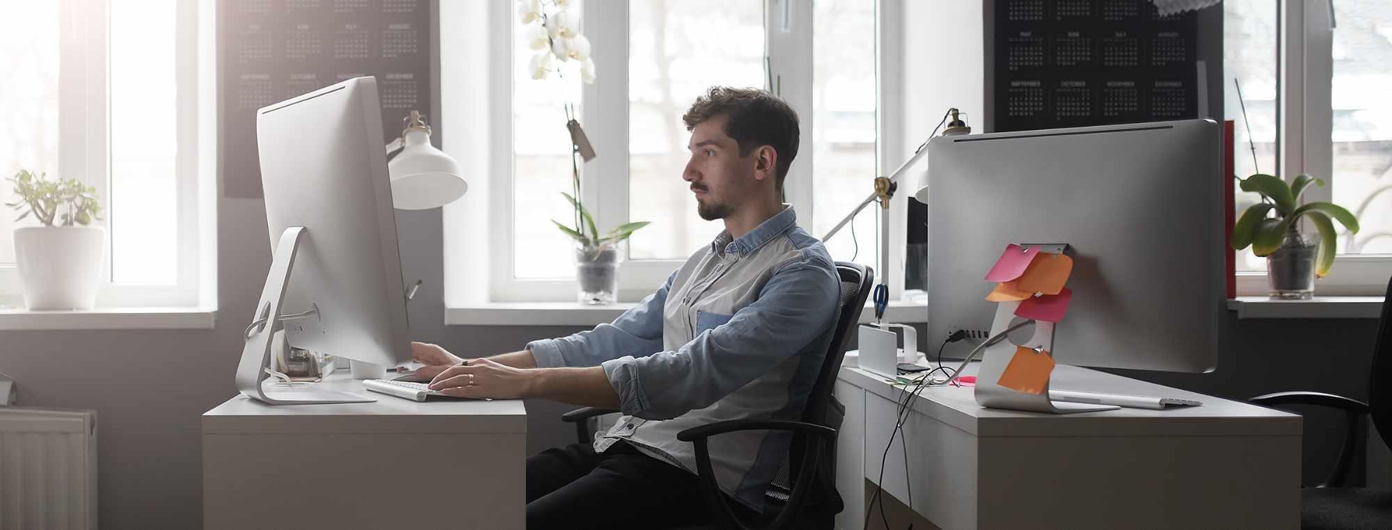 a-man-working-in-a-modern-design-office-HTGZ68F.jpg